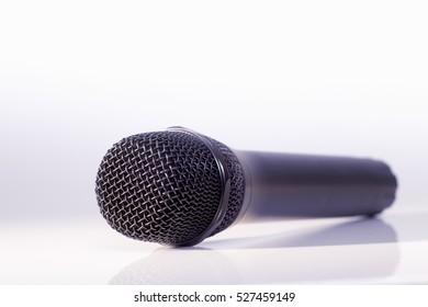 Black metallic microphone in a bright background