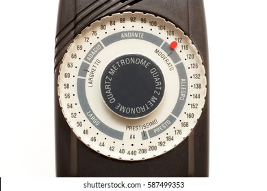 Black metronome with white select wheel on pure white background.
