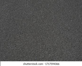 Black micro sponge texture. Soft rubber material background with a high resolution suitable for graphic, top view.