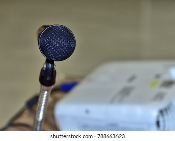 A black microphone in conference room