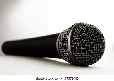 A black microphone isolated on white background