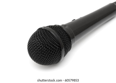 Black microphone isolated on a white background.