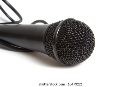 Black microphone over white background