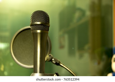 Black microphone in recording room