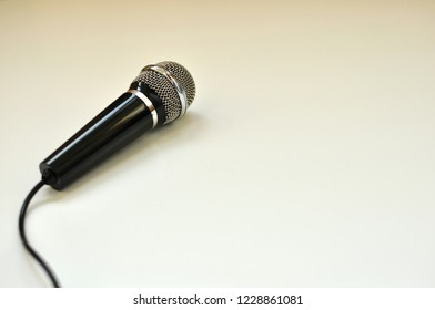 Black microphone view from top side, isolated on white background with copy space