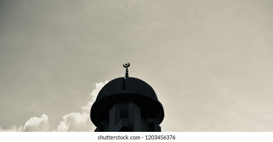 A black minarets of a mosque unique photo