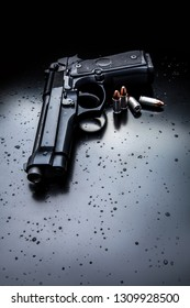 black modern gun on black background. 9mm pistol gun on black
