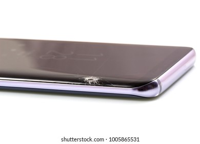 Black modern & new touch screen smartphone with broken screen isolated on white background.