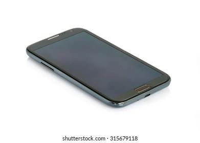 Black modern smartphone isolated on white background.