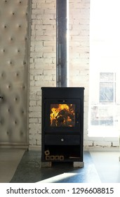 black modern stove fireplace in sunny room