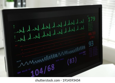 Black monitor with cardiogram in hospital, closeup