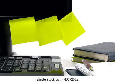 Black monitor with sticky notes to put your own text on. White background