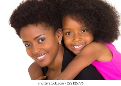 Black mother daughter posing happily looking upwards smiling