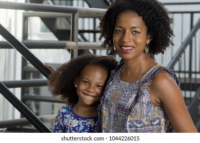 Black mother with her school age daughter
