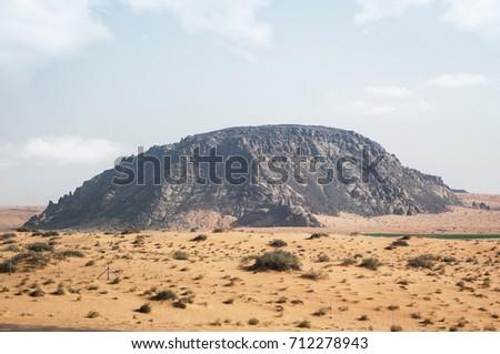 black-mountain-desert-clouds-on-450w-712