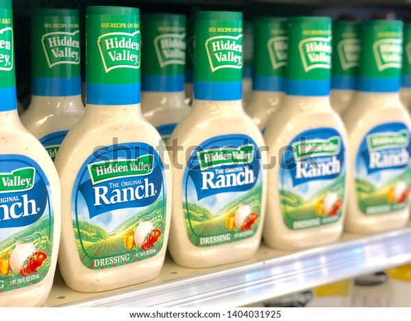 Black Mountain, NC / USA - May 21, 2019: This is a color photo of 16 oz. size bottles of Hidden Valley Ranch dressing on the shelf at a local grocery store.