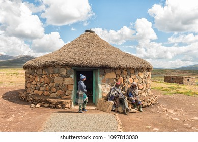 BLACK MOUNTAIN PASS, LESOTHO - MARCH 24, 2018: Unidentified Basotho people in front of a shop in the Mamokae village at the foot of the Black Mountain Pass