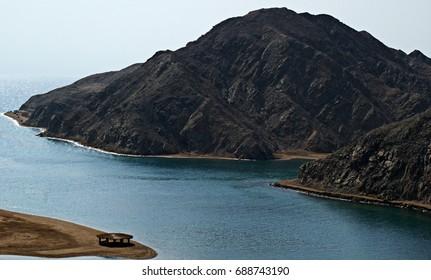 Black mountain in the Red sea. Egypt. Sinai.