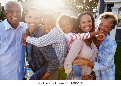Black multi generation family outside, backlit portrait