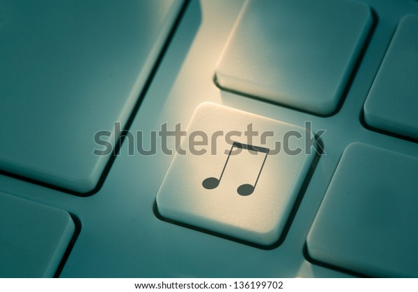 Black music note button on white keyboard