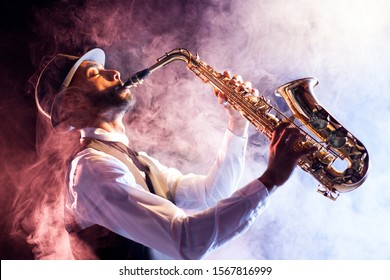 Black musician playing saxophone. Old style jazz.