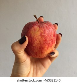 Black nails and apple