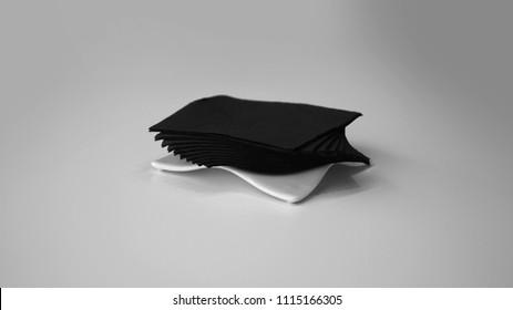 Black napkins on white napkin holder