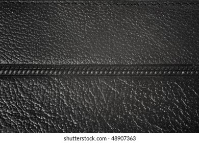 Black natural leather background with stitch