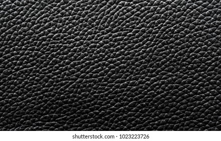 Black natural leather close-up background, gray leather texture, dark background texture with pattern, black skin
