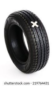 black new tire with patch on white background