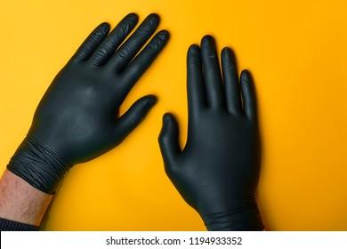 Black nitrile or latex gloves