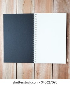 The black notebook with metal ring and wood floor