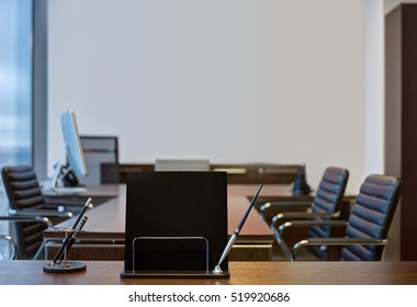 Black notebook with pen on the table in modern office