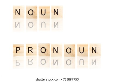 Black noun and pronoun word  with reflection, on wooden blocks on white background, Isolated.