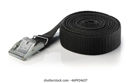 Black nylon cam lock tie down strap isolated on white with natural reflecrtion.