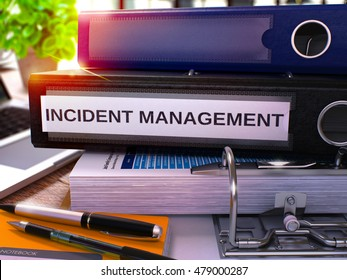 Black Office Folder with Inscription Incident Management on Office Desktop with Office Supplies and Modern Laptop. Incident Management Business Concept on Blurred Background. 3D Render.