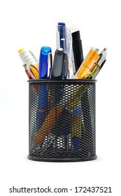 Black office pot with pencils and pens on a white background.