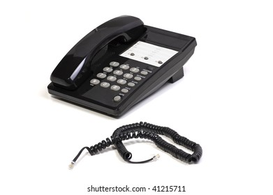 Black Office Telephone and Phone Cord on White Background