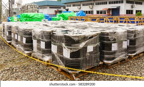 Black oil barrels or chemical drums stacked up at storage area in power substation