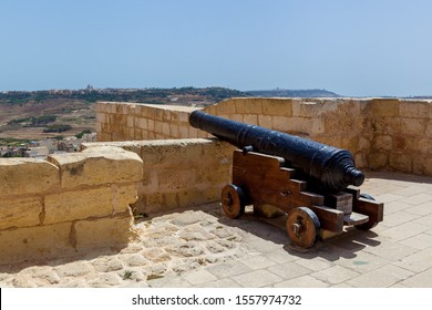 Black old cast iron cannon at Citadel Victoria. Citadel Victoria is a fortified city of St. John's bastion inside the citadel of Malta. Gozo Island. UNESCO World Heritage Site.