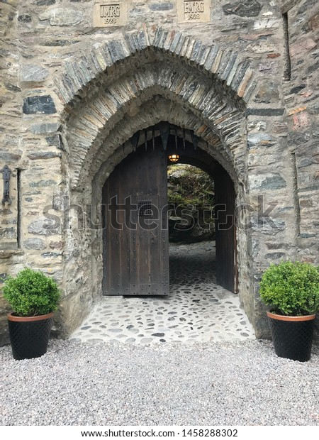 Black, old door to a stone castle.