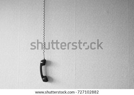 Superb Black Old Handset Wire Hang Against Stock Photo Edit Now 727102882 Wiring 101 Nizathateforg