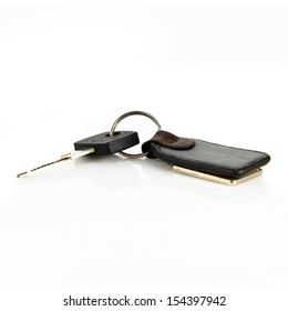 Black old key chain over white background