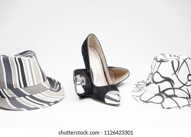 black old ladies shoe on high heels with a hat on a white background
