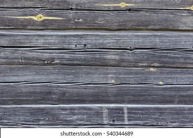 Black Old Log Cabin Wall Texture. Dark Rustic House Log Wall. Horizontal Timbered Background. Unpainted Gray Wooden Debarked Barn Facade Wallpaper.
