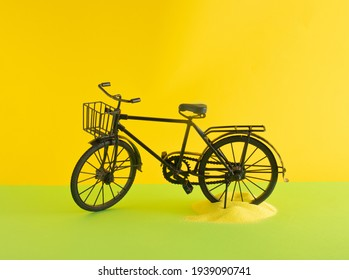 black old retro vintage bike and yellow sand on sunny yellow and