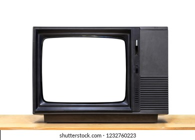 Black old television with clipping path on wooden table with isolated on white background