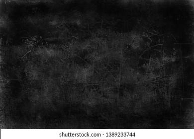 黒い古い壁のひびのあるコンクリート背景/抽象的黒テクスチャー、ビンテージ古い背景