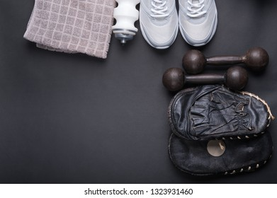 black older punch pads for boxing training with accessories on dark background