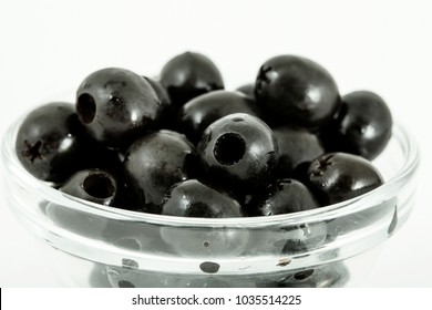 Black olives in glass plates isolated on the white background